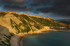 Cliffs of clay (snowyturner) Tags: light sunset sea tower bay mediterranean shadows malta cliffs clay limestone tuffieha ghajn gneja