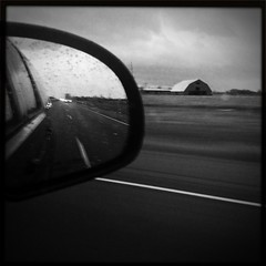 Wet roadside -  I-10, Cheek, TX. (mikerastiello) Tags: road blackandwhite reflection barn mirror lomo lomography texas cheek tx noflash roadside beaumont iphone beaumonttexas beaumonttx iphonelomography hipstamatic blackeyssupergrainfilm gsquadlens cheektexas cheektx