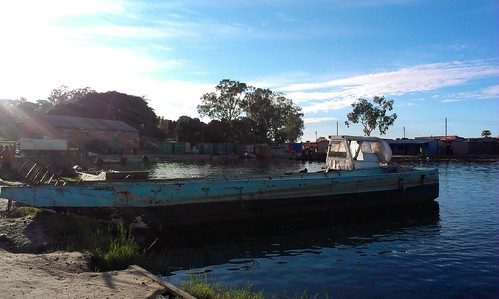Boat at Mongu harbour, Zambia. Photo by Froukje Kruijssen, 2013.