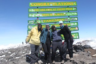 Lindsey with her guides at the summit