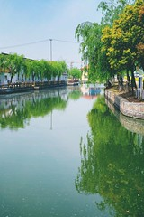The canal in front of Zhujiajiao (norsez (Thank you for 7,000 views)) Tags: china 35mm lens thailand aperture raw fuji shanghai bokeh f14 thai fujifilm fujinon xf cmos xp1 fastlens apsc xpro1 xtrans thaiphotographer xmount 52mmequivalent fujixpro1 fujifilmxpro1