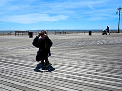 Photographer, Coney Island (Timbo_a_go_go) Tags: pictures wood sea holiday island coast photo photographer shore boardwalk slats coney seafront