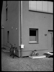137. (Sweet Grain Oh Mine) Tags: blackandwhite bw house bike bicycle 35mm canon dark hc110 400 demi ee17 ilford canoscan fahrrad 139 asa400 p4 selfdeveloped a300 finegrain colorneg vuescan isp4 9000f