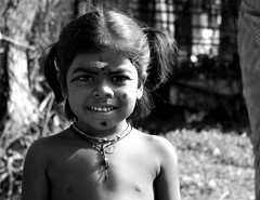 Neighbour's boy (Ros Yameni) Tags: portrait blackandwhite india smile kid child religion culture hinduism tamilnadu rituals kattumannarkoil