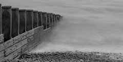Groyne (SMugridge) Tags: sea white mist black canon 350d blackwhite pebble filter nd eastbourne groyne density 70200mm neutral