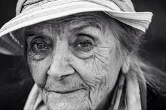 Elder beauty (Giulio Magnifico) Tags: woman beauty face look hat closeup lady eyes sweet profile streetphotography streetportrait soul elder eyebrow gaze udine nikond800e nikkormicro105mmafsvrf28