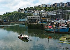 Mevagissey Harbour (john atte kiln) Tags: mevagissey harbour mevagisseyharbour mevagisseyharbor houses terraces quayside quay parked moored cornwall england britain uk unitedkingdom boat harbor harbourwall harborwall water rowingboat mooredboat reflections outdoor ship buoys aquarium masts slipway clouds blues