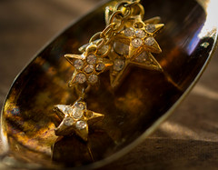Golden Starlight (Captured Heart) Tags: stars golden macro macromondays jewelry spoon gold