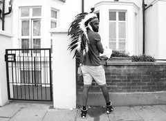 Caught in the Act (Becky Frances) Tags: beckyfrances blackandwhite blackandwhitestreetphotography city candid carnival england london lensblr nottinghill nottinghillcarnival olympus streetphotography socialdocumentary summer urban uk 2016