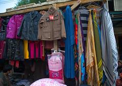 Burka for sale in the market, Badakhshan province, Ishkashim, Afghanistan (Eric Lafforgue) Tags: afghan448 afghanistan badakhshanprovince blue border burka burqa centralasia colourimage eshkashem horizontal ishkashem ishkashim mickeymouse nopeople nobody outdoors pamir photography religiousdress scarf traditionalclothing wakhan