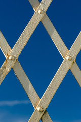 Footbridge (mikeplonk) Tags: bridge footbridge trefforest pontypridd southwales diamond parallelogram blue white sky cloud cpl polarisingfilter polarizingfilter arrivatrainswales trenauarrivacymru nikon d5100 18140mm closeup abstract minimal minimalist minimalism symmetry symmetrical iron rust