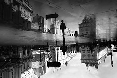 Quo Vadis (explored) (Robert-Jan van Lotringen) Tags: london water strange flip color atmosphere city town people reflection rain surprise england cityscape dream street puddle piccadilly circus uk candid streetphotography boy puddlegram piccadillycircus upsidedown mirror inversion