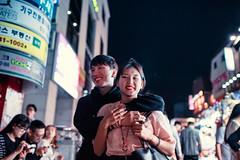 Lovers (Jon Siegel) Tags: nikon d810 sigma 24mm 14 sigma24mmf14art man woman boy girl cute smiling happy walking street night evening people youth hongdae korean korea seoul southkorea