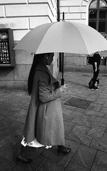 Umbrella series (Helsinki Drifter) Tags: streetphotography personalseries umbrella coat lady urban streetscene blackandwhite film 35mm rollei retro400s pushprocess contrast tones helsinki finland europe walkingby inmotion canona1 surveillancefilm aviphot