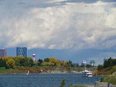 Clouds above downtown Calgary (benlarhome) Tags: weaselhead glenmorereservoir glenmorepark calgary canada alberta nwn thebow calgarytower