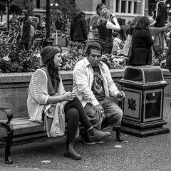 Enjoying Conversation (jsnmckenzie) Tags: victoria vancouverisland victoriabc britishcolumbia black white bc bw bench people sitting outdoor street streetphotography