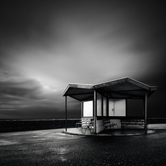 Resting Place (Andy Brown (mrbuk1)) Tags: longexposure blackwhite mono shelter bench seats mood light westonsupermare somerset roof windows square stormy wet cloudy moody dark gloomy landscape shadow melancholic contrast artlibres wideangle bwfilters leefilters