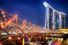 Marina Bay Sand 06 (yewkwangphoto) Tags: sea seascape water horizontal museum architecture skyscraper reflections shopping landscape singapore cityscape bluesky tourist nightscenery placeofinterest commercialbuildings buildingstructure photocategory marinabaysand yewkwang artsciencemuseum thehelixbridge photographybyyewkwang