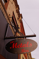Sign for the Metals Bar, Wallace, ID (CT Young) Tags: idaho wallace smalltown silvervalley centeroftheuniverse idahopanhandle ruralwest wallaceid shoshonecounty miningcity canonefs18135mmf3556is