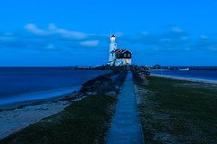 """The famous lighthouse """"Paard van Marken"""" of Marken, the Netherlands (Maria_Globetrotter) Tags: world travel blue vacation lighthouse holiday holland water netherlands beautiful dutch by fairytale night wonderful faro concrete spring nice fantastic perfect europe long exposure pretty view postcard awesome sightseeing nederland visit tourist best clear hour stunning planet destination romantic lonely sight traveling lovely straight typical visiting majestic incredible picturesque paysbas phare vuurtoren blauwe breathtaking pases marken fyr frhling  holand vr bl blaue  bajos uur  stunde timmen nederlnderna 650d   paardvanmarken mariaglobetrotter"""