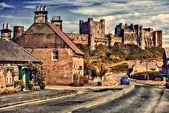 Castle From Main Street (Light+Shade [spcandler.zenfolio.com]) Tags: street uk england streets castle history buildings town village streetscene historic northumberland historical bamburgh streetview lightshade bamburghcastle stephencandler stephencandlerphotography spcandler httpspcandlerzenfoliocom stephencandlerphotography