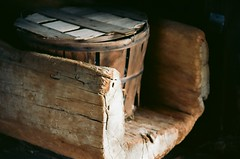 Weathered (Kendall Seitz) Tags: weathered wood bucket log trough lowkey film conservancy crate old barn vignette flickr farm morning history sunshine shadow shadows outside rural dof depthoffield country bright home gold exposure art stilllife sun summer yellow food macro