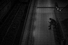 Street, traveller (Dagelijksbrood) Tags: 2016 belgium antwerpen europe premetro subway dark night bw blackwhite monochrome street citylife city waiting f18g 35mm nikon d3300 g nikkor indoor straatfotografie blackandwhite nacht people cool photography man sitting dramatic human new candid world railway downtown flickr digital