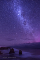 Starry skies over the Apostles (Howard Ferrier) Tags: oceania landmass milkyway gibsonsteps astrophotography portcampbellnp southernocean southwest ocean purple astronomy island sky victoria twelveapostles stack stars australia princetown au photography