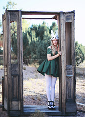 Lost Along the Way (Kelly McCarthy Photography) Tags: woman model beautiful beauty fashion style fairytale dress green greendress catchycolorsgreen mask rabbitmask bunnymask whitemask tights polkadots polkadotdress bokeh bokehwhores trees outdoors woods forest doorway doorframe blonde
