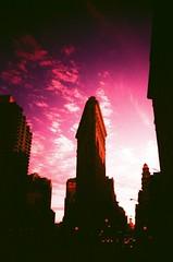 Flat Iron at Dusk #1 (-=Cheese=-) Tags: nyc newyorkcity xpro crossprocessed manhattan midtown flatiron fujiastia100 vivitarultrawideslim blackslimdevil