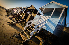 Beach Huts (Scott Baldock Photography) Tags: uk sunset sea england art beach dutch thames architecture bay coast seaside spring sand angle estuary thorpe gb riverthames essex beachhuts southendonsea d7000