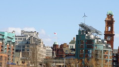 Panorama of area south of Manchester city centre, including Green Building and clock tower of Palace Hotel from Medlock Street (Alex Pepperhill) Tags: clock manchester flag clocktower palacehotel windpower solarpower greenbuilding englishflag stgeorgescross medlockstreet