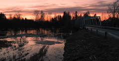 Spring flood (River Kyrnjoki) (iletus) Tags: bridge light sunset red orange reflection ice water field yellow night suomi finland river photography spring nikon warm flood tripod 1855 float vesi valo ilmajoki heijastus silta joki kevt d3100