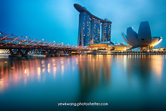 Marina Bay Sand 05 (yewkwangphoto) Tags: sea seascape water horizontal museum architecture skyscraper reflections shopping landscape singapore cityscape bluesky tourist nightscenery placeofinterest commercialbuildings buildingstructure photocategory marinabaysand yewkwang artsciencemuseum thehelixbridge photographybyyewkwang