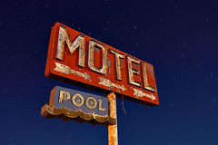 motel. yucca, az. 2013. (eyetwist) Tags: road longexposure arizona moon classic abandoned pool sign night america vintage dark stars typography photography route66 nikon waves desert tripod mother rusty motel roadtrip 66 gone fullmoon route moonlit type americana moonlight weathered interstate arrow 40 roadside nikkor bros derelict arid yucca whiting i40 startrails mojavedesert typographic eastbound sansserif vanished eyetwist whitingbros d7000 eyetwistkevinballuff 1024mmf3545g
