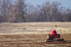 Plowing in Red (giantmike) Tags: tractor field spring farm farming farmer plow wi canonef100400mmf4556lis
