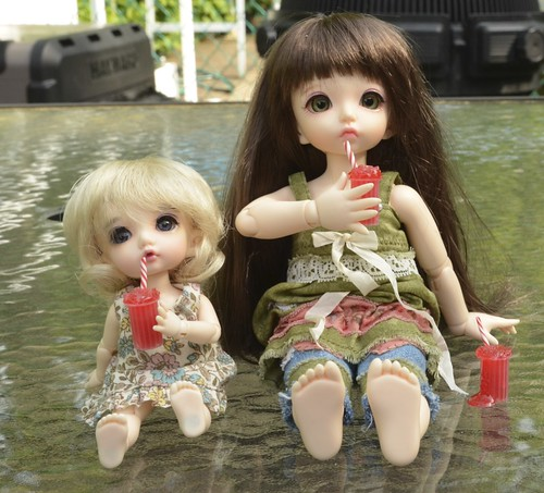 Yum They are both enjoying Slushies from Dolly Details