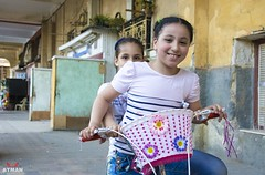 Childhood l  (Ayman Abu Elhussin) Tags: 2016 aymanabuelhussin     street streetshot  streetlife nikon7100 arab  egypt portsaid portsaidegypt    people outdoor  smile   port face young clear life child     girl bicycle happy summer
