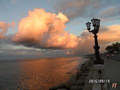 Giochi di Luce (triziofrancesco) Tags: nubi nuvole clouds sky cielo triziofrancesco luci colori colours orange mare sea bari puglia reflection italy lungomare lampione riflesso