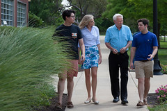 Jack walks with U of Indy students