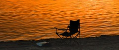 """And that's the kind of day it's been."" (janet.capling) Tags: westburo beach ottawa sunset chair newspaper relaxing read news sand water lloydrobertson"