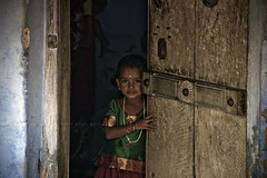 (Kals Pics) Tags: life door portrait people india house man history home girl canon kid god good bad expressions culture evil holy doorway disguise gods tradition tirunelveli legend mythology goddesses myth tamilnadu dasara villagepeople dussehra cwc villagelife rurallife ruralindia indianvillages 550d udangudi dhaavani ruralpeople dhasara kulasai  kulasekharapatnam 18135mmis chennaiweelendclickers udankudi kulasekharapattinam