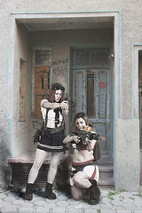 Doorway defence (Hi, I'm Tim.) Tags: model girl shooting guns act acting texture composite action timlarge tacraftphotography tacrafts teen teenage teenager skirt short sisters cosplay shot twins