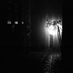 Erice (Peter Gutierrez) Tags: street light shadow bw italy white black streets building film blanco public fog architecture night contrast buildings dark square evening noche photo italian europe italia european nocturnal time nacht pavement negro foggy medieval sidewalk nighttime gutierrez sicily nuit bianco blanc nocturne notte erice italians italiano trapani italiana sicilian noire siciliano eryx siciliana peter gutierrez