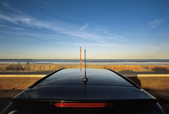 Supercar at the beach (Shade-of-Light) Tags: greatbritain blue red sea england sky reflection beach nature glass car horizontal landscape outdoors photography daylight horizon rear beautifullight nobody daytime parked elegant seafront idyll southshields luxury supercar antenna scenics clearsky tranquilscene carantenna carpart tyneandwear unusualangle saturatedcolour northeastengland diminishingperspective beautyinnature nonurbanscene portabagagli horizonoverwater imagecreated2000s imagecreated21stcentury