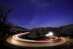 Lariat Loop (Geometric Visuals) Tags: night star stars color sky mountains road circle streaks tree trees longexposure light lights mountain long exposure