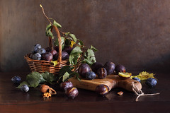 The Scorched Plums Of Dusk (panga_ua) Tags: thescorchedplumsofdusk plums plumleaves fruits purple basket kitchenboard cuttingboard oakwood walnut autumn september woodentabletop paintedbackground imagination spectacular poetic creation artwork art artistic arrangement composition stilllife bodegon naturamorta naturemorte tabletop sharpfocus availablelight canon artphotography artisticphotography presentation nataliepanga ukraine rivne natalie panga