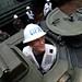 Rear Adm. tours an amphibious assault vehicle in the well deck of USS Germantown.