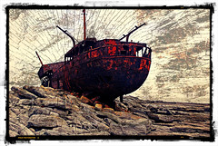 Rusted hulk of a ship wrecked on the rocks of Inisheer, the smallest of the Aran Islands off the wild Atlantic coast of Ireland done up in the photo app Pixlromatic (elizabatz.jensen) Tags: rust ship wrecked rocks inisheer aranislands wild atlantic coast ireland photoapp pixlromatic