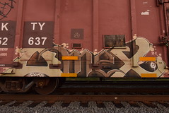OMEX (TheGraffitiHunters) Tags: graffiti graff spray paint street art colorful freight train tracks benching benched boxcar omex